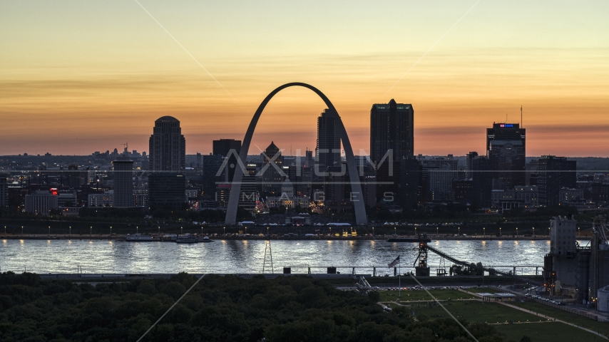 A view across the river at Downtown St. Louis, Missouri, twilight Aerial Stock Photos | DXP001_030_0004