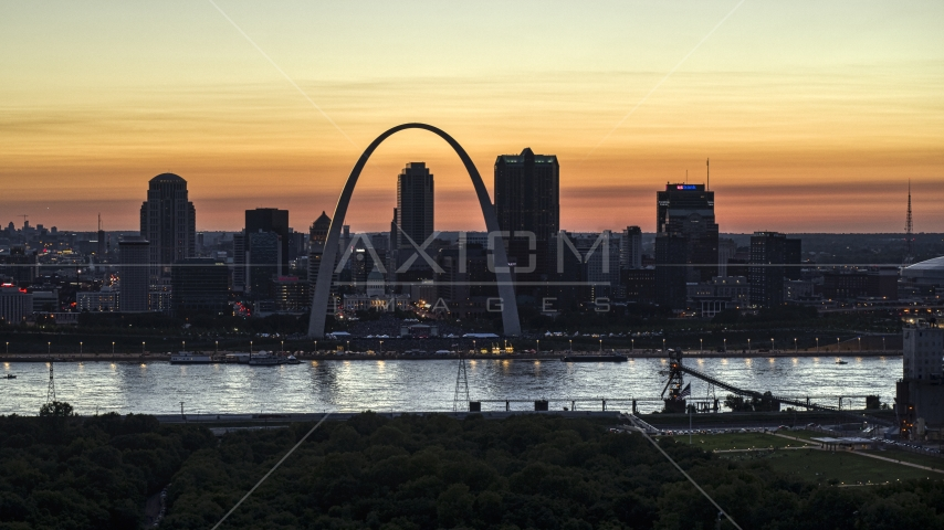 The Downtown St. Louis, Missouri skyline across the Mississippi River at twilight Aerial Stock Photos | DXP001_030_0005