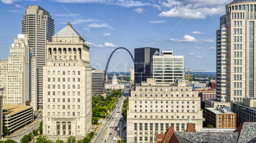 The Gateway Arch and museum visible between courthouses in Downtown St. Louis, Missouri Aerial Stock Photos | DXP001_031_0005
