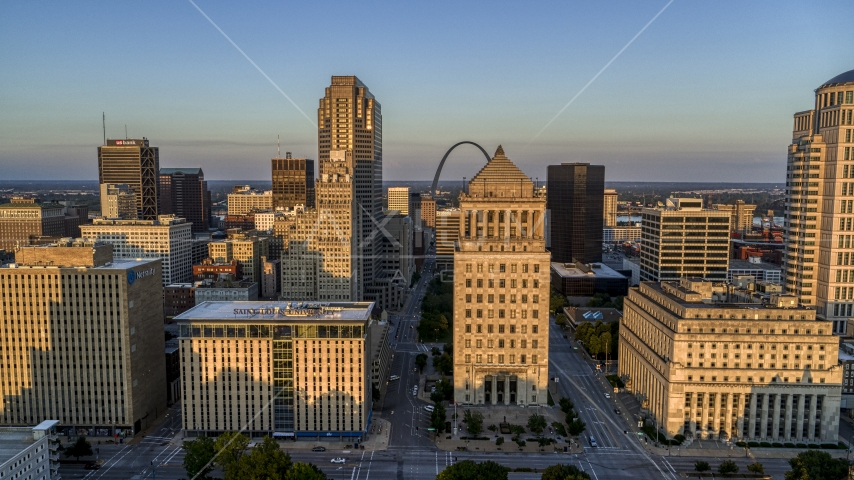 Gateway Arch behind courthouses at sunset, Downtown St. Louis, Missouri Aerial Stock Photos | DXP001_035_0005