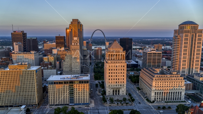 Federal courthouses and the famous Arch at sunset, Downtown St. Louis, Missouri Aerial Stock Photos | DXP001_036_0001