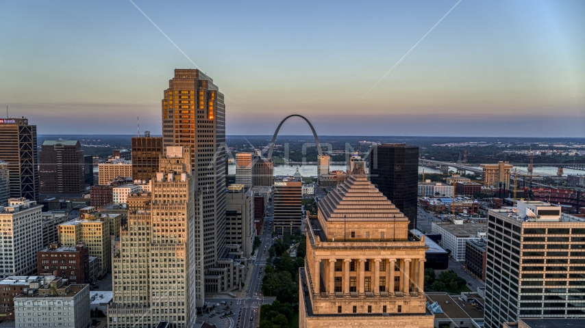 The Gateway Arch seen from the top of a downtown courthouse at sunset, Downtown St. Louis, Missouri Aerial Stock Photos | DXP001_036_0003