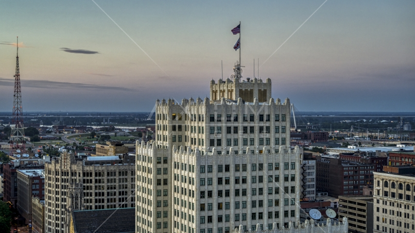 A view of flags atop a downtown apartment building at twilight, Downtown St. Louis, Missouri Aerial Stock Photos | DXP001_036_0007