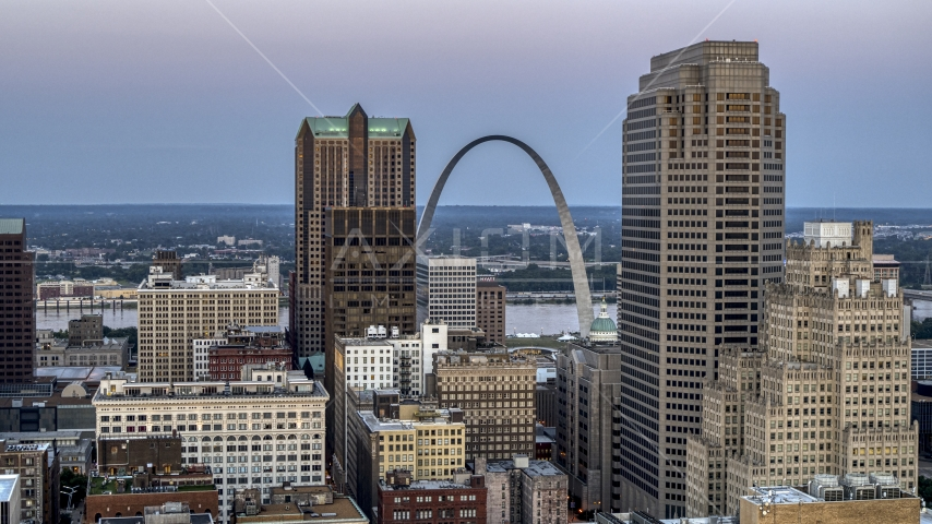 The Gateway Arch visible between two tall skyscrapers at twilight, Downtown St. Louis, Missouri Aerial Stock Photos | DXP001_036_0010
