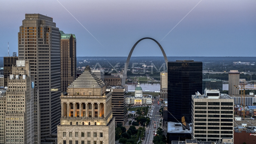 The Gateway Arch and museum at twilight, seen across Downtown St. Louis, Missouri Aerial Stock Photos | DXP001_036_0012