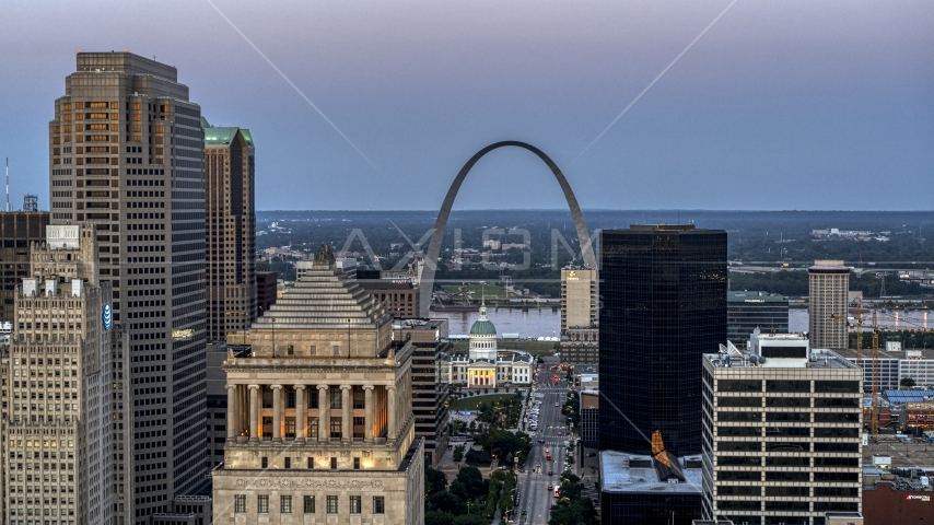 A view of the Gateway Arch and museum at twilight seen across Downtown St. Louis, Missouri Aerial Stock Photos | DXP001_036_0013