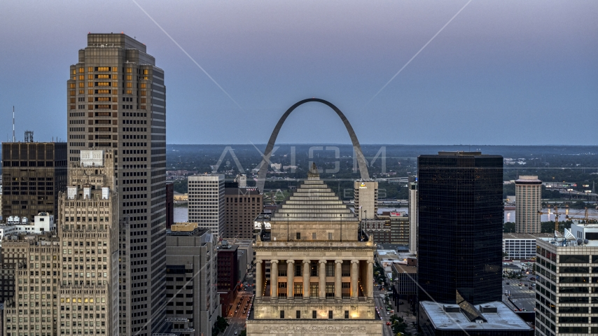 Gateway Arch at twilight, visible from a courthouse in Downtown St. Louis, Missouri Aerial Stock Photos | DXP001_036_0014