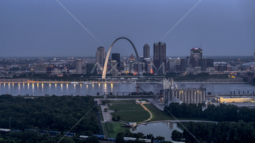 The Gateway Arch at twilight, visible from across the Mississippi River, Downtown St. Louis, Missouri Aerial Stock Photos | DXP001_037_0001