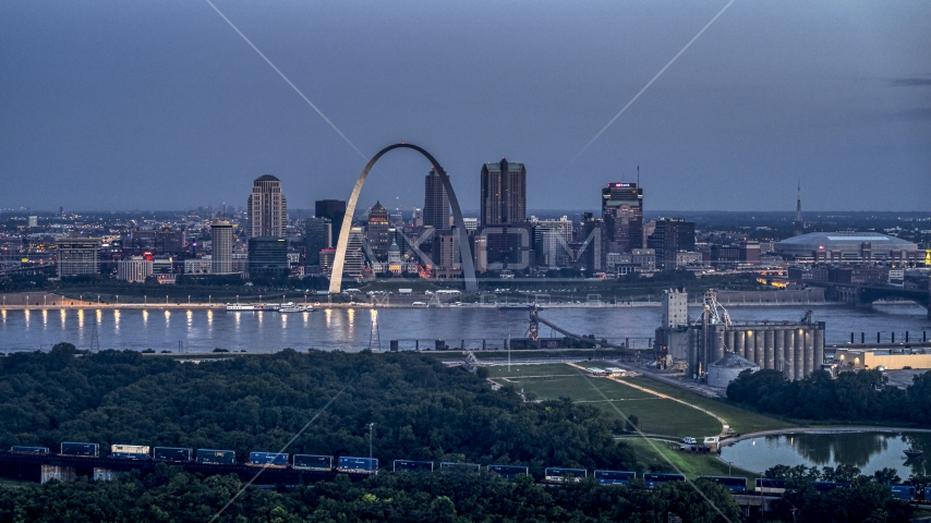 The Gateway Arch and the Mississippi River at twilight, Downtown St. Louis, Missouri Aerial Stock Photos | DXP001_037_0003