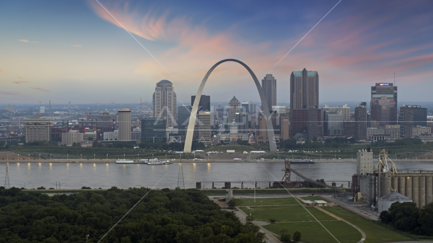 Gateway Arch and Downtown St. Louis, Missouri, beside the Mississippi River at twilight Aerial Stock Photos | DXP001_037_0007