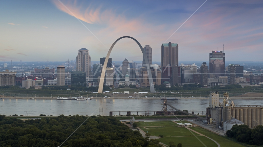 The Arch and skyline in Downtown St. Louis, Missouri, by Mississippi River at twilight Aerial Stock Photos | DXP001_037_0010