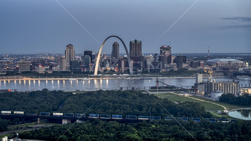 The famous Gateway Arch across the Mississippi River at twilight, Downtown St. Louis, Missouri Aerial Stock Photos | DXP001_037_0011