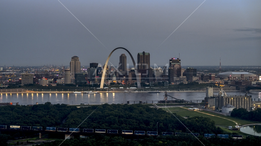 A view of the Gateway Arch and the Mississippi River at twilight, Downtown St. Louis, Missouri Aerial Stock Photos | DXP001_037_0012