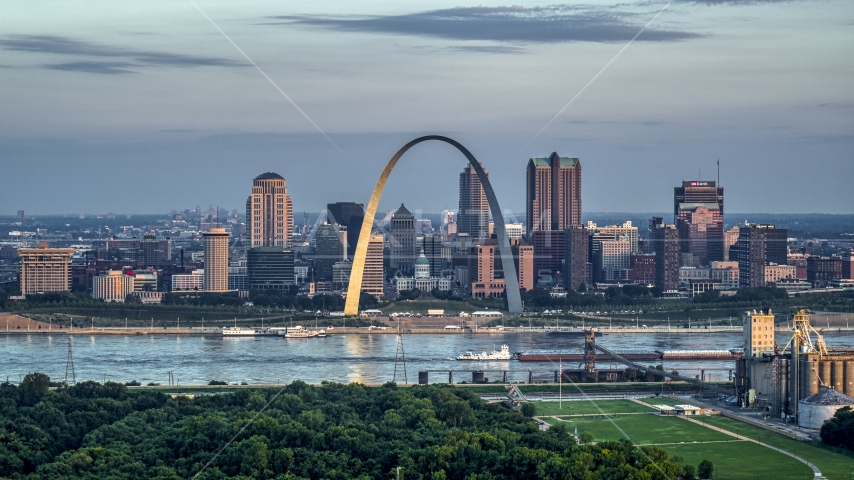 A view of the Gateway Arch by the Mississippi River at sunrise in Downtown St. Louis, Missouri Aerial Stock Photos | DXP001_038_0004