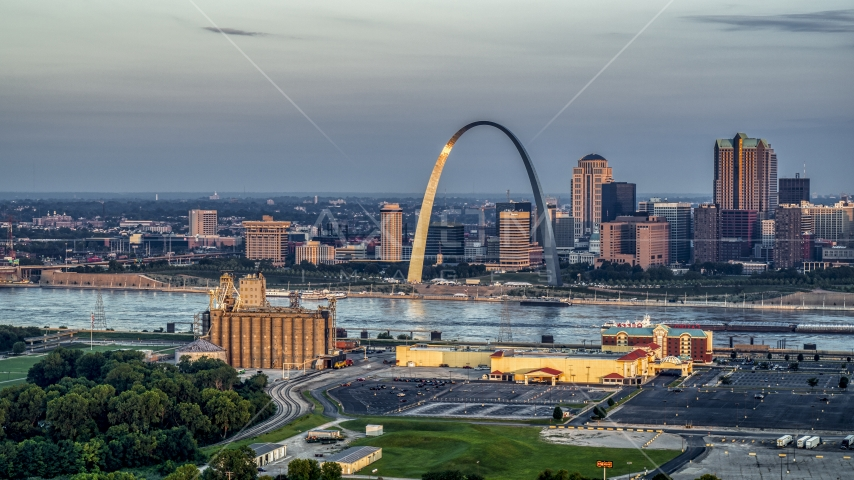 Sunlight on the St. Louis Arch by the Mississippi River at sunrise in Downtown St. Louis, Missouri Aerial Stock Photos | DXP001_038_0005