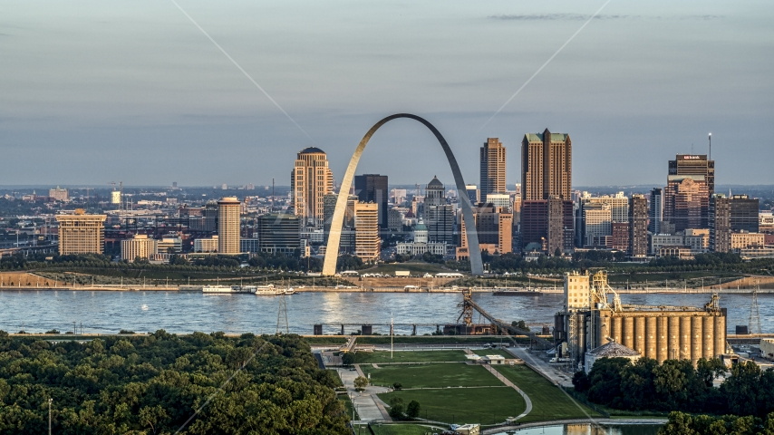 The St. Louis Arch beside the river at sunrise in Downtown St. Louis, Missouri Aerial Stock Photos | DXP001_038_0006