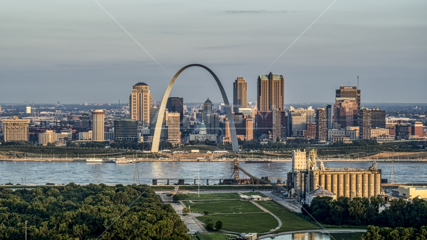 A view of the St. Louis Arch and the city skyline at sunrise in Downtown St. Louis, Missouri Aerial Stock Photos | DXP001_038_0007