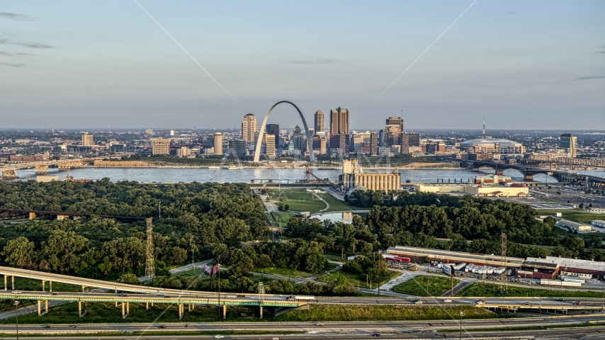 A wide view of the Gateway Arch in the morning, seen from I-55, Downtown St. Louis, Missouri Aerial Stock Photo DXP001_038_0008 | Axiom Images