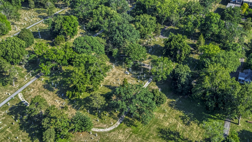 Gravestones and trees at a cemetery in Kansas City, Missouri Aerial Stock Photos | DXP001_044_0004