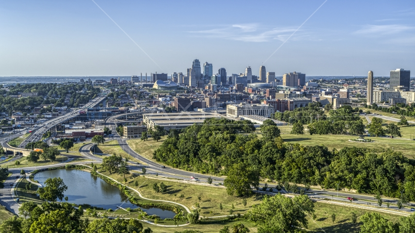 The city skyline seen from a small lake by Broadway Boulevard, Downtown Kansas City, Missouri Aerial Stock Photo DXP001_045_0004 | Axiom Images