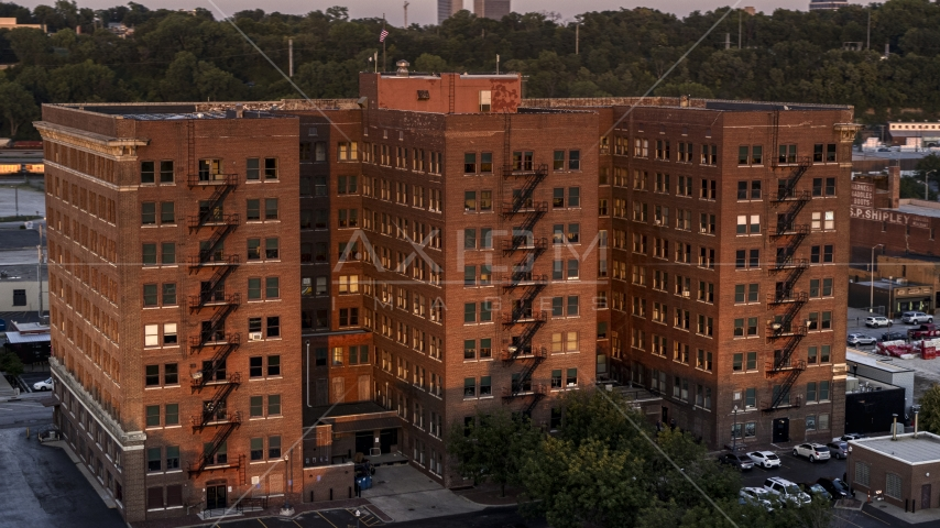 A brick office building at twilight in Kansas City, Missouri Aerial Stock Photo DXP001_046_0003 | Axiom Images
