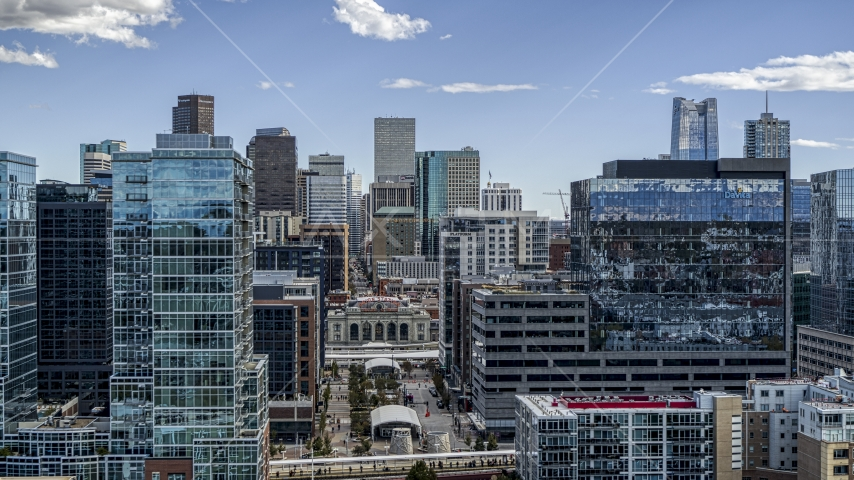 The city's skyline behind office buildings in Downtown Denver, Colorado Aerial Stock Photos | DXP001_055_0007