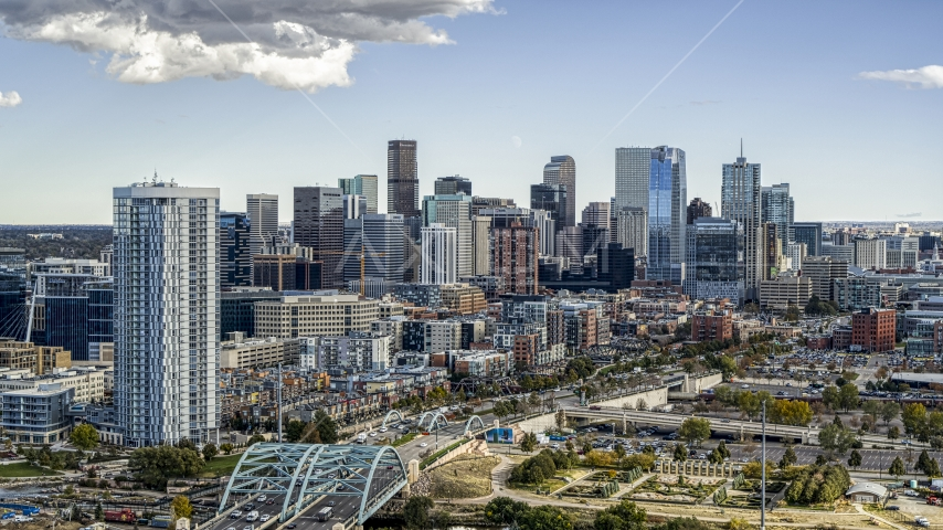 The city's skyline and a residential skyscraper in Downtown Denver, Colorado Aerial Stock Photos | DXP001_055_0011