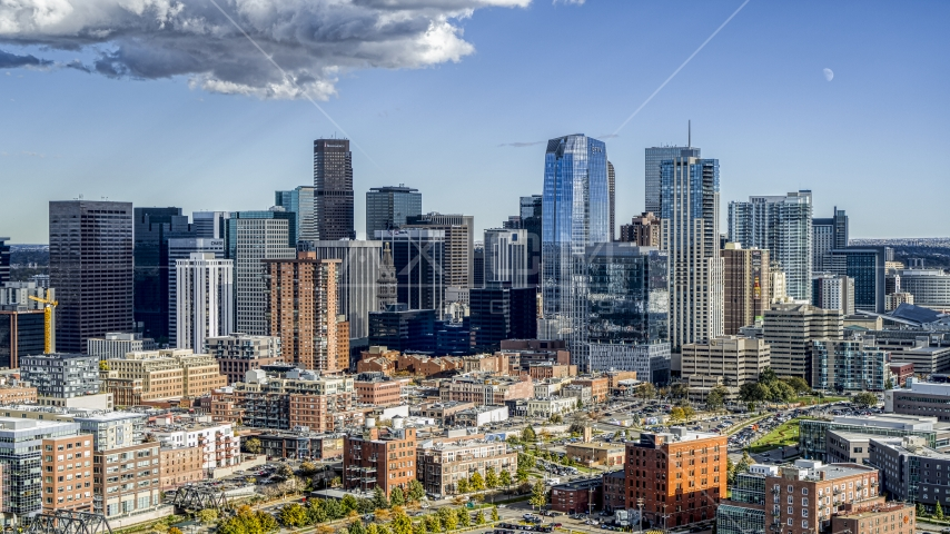 A view of towering skyscrapers of the city skyline in Downtown Denver, Colorado Aerial Stock Photo DXP001_055_0014 | Axiom Images