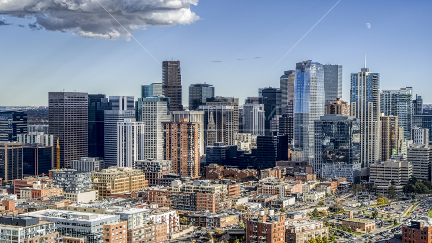 The towering skyscrapers of the city skyline in Downtown Denver, Colorado Aerial Stock Photos | DXP001_055_0016