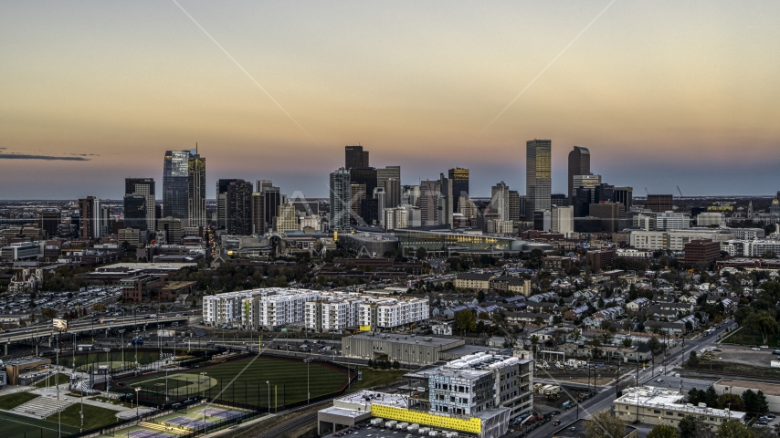 Wide view of the city's skyline at sunset, Downtown Denver, Colorado Aerial Stock Photos | DXP001_057_0001