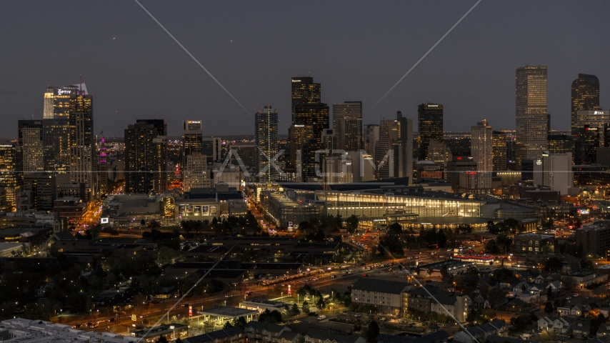 The city's skyline behind the convention center at twilight, Downtown Denver, Colorado Aerial Stock Photos | DXP001_057_0007