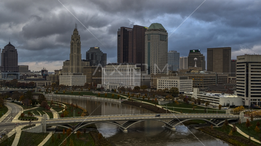 A view of the city skyline from a bridge spanning the Scioto River, Downtown Columbus, Ohio Aerial Stock Photo DXP001_087_0003 | Axiom Images