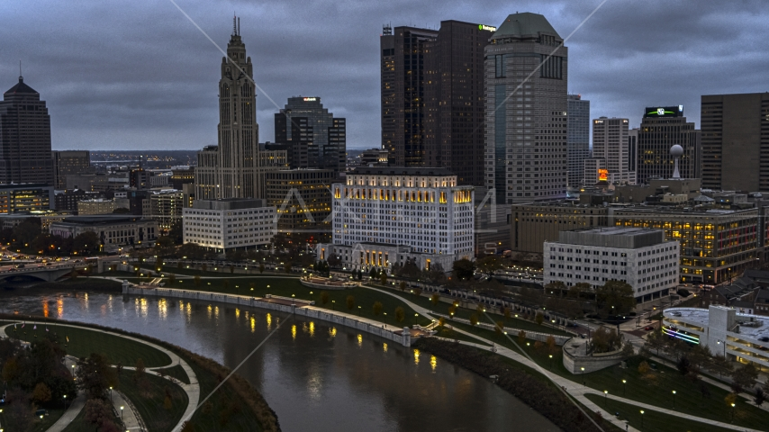 The city skyline and the Scioto River at twilight, Downtown Columbus, Ohio Aerial Stock Photo DXP001_087_0007 | Axiom Images
