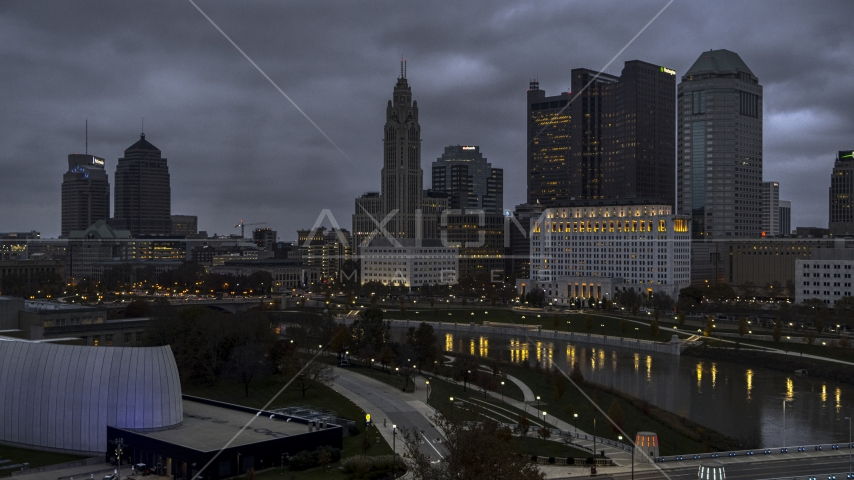 A view of city skyline at twilight from near the river in Downtown Columbus, Ohio Aerial Stock Photos | DXP001_087_0010