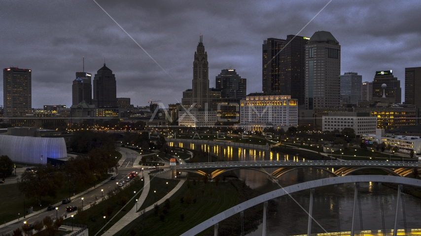 The city skyline at twilight seen from the river and bridges in Downtown Columbus, Ohio Aerial Stock Photos | DXP001_087_0011
