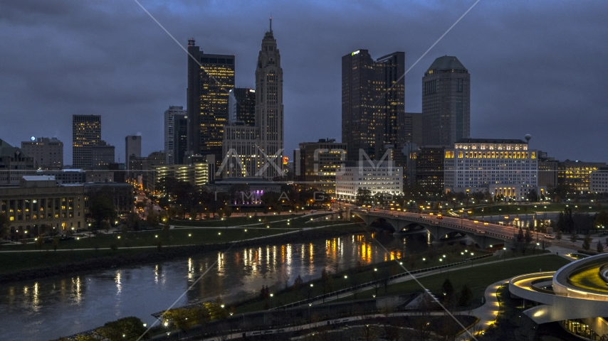 The city skyline across the river at twilight, Downtown Columbus, Ohio Aerial Stock Photo DXP001_088_0001 | Axiom Images