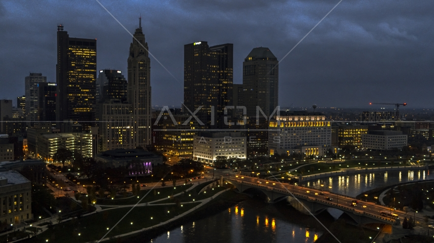 The city's skyline beside a bridge and river at twilight, Downtown Columbus, Ohio Aerial Stock Photos | DXP001_088_0006