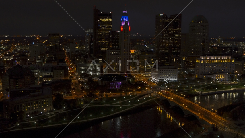 The city skyline, and bridge spanning the river at night, Downtown Columbus, Ohio Aerial Stock Photos | DXP001_088_0013