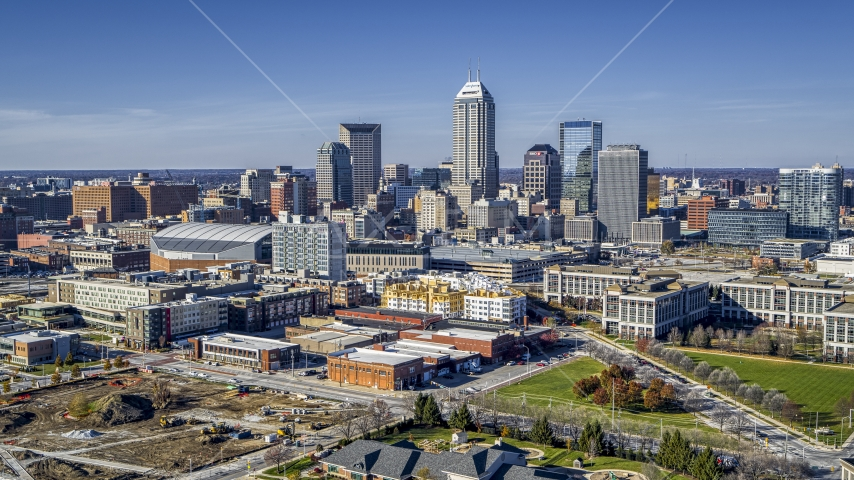The city's skyline in Downtown Indianapolis, Indiana seen from smaller brick buildings Aerial Stock Photos | DXP001_090_0005