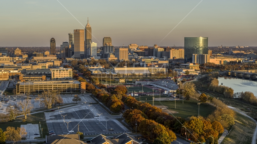 A view of the city's skyline at sunset, Downtown Indianapolis, Indiana Aerial Stock Photos | DXP001_092_0006