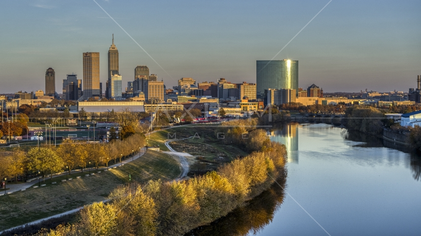 The city's skyline at sunset seen from White River, Downtown Indianapolis, Indiana Aerial Stock Photos | DXP001_092_0007