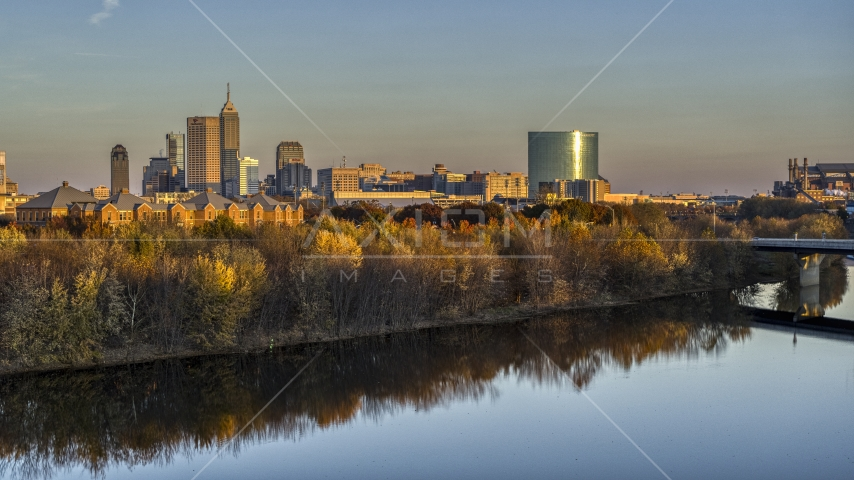 The city's skyline at sunset, seen from low over White River, Downtown Indianapolis, Indiana Aerial Stock Photos | DXP001_092_0008