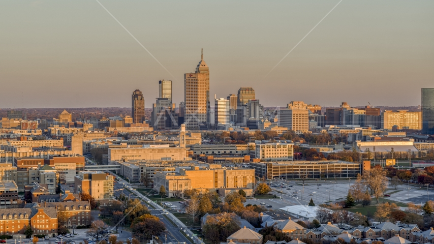 A wide view of the city's downtown skyline at sunset, Downtown Indianapolis, Indiana Aerial Stock Photos | DXP001_092_0011