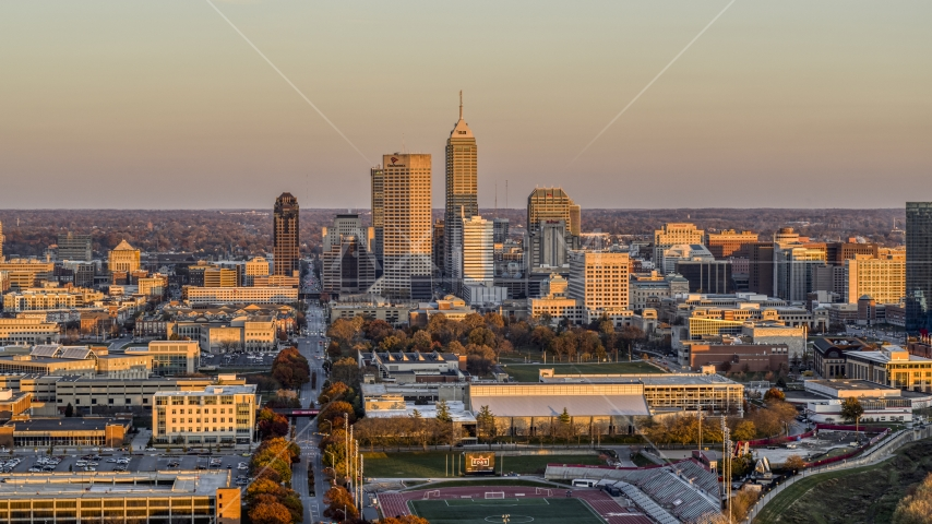Wide view of the city's downtown skyline at sunset, Downtown Indianapolis, Indiana Aerial Stock Photos | DXP001_092_0012