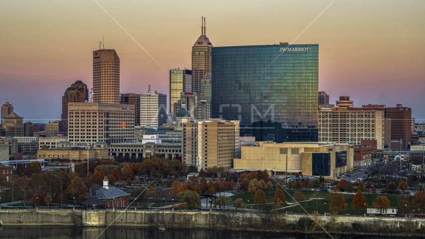 A hotel and the city's skyline at sunset, Downtown Indianapolis, Indiana Aerial Stock Photos | DXP001_092_0013