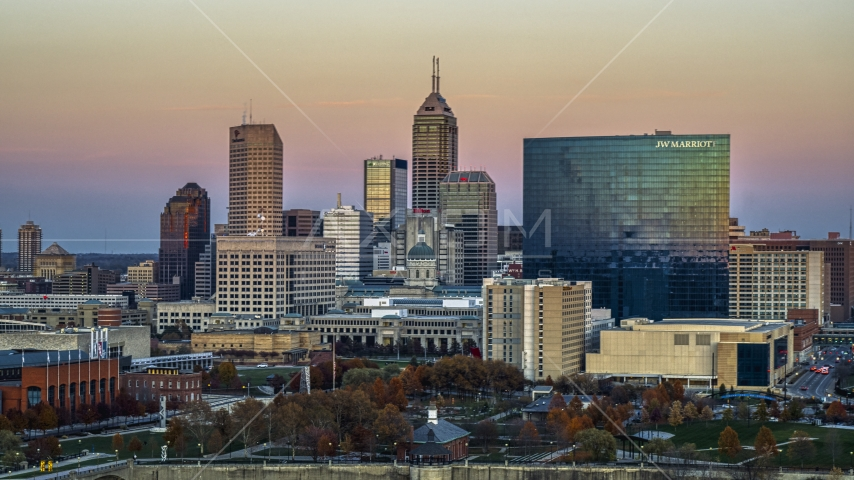 A hotel and view of the city's skyline at sunset, Downtown Indianapolis, Indiana Aerial Stock Photos | DXP001_092_0014