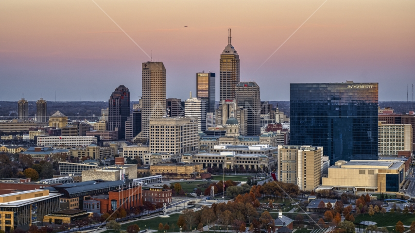 Hotel and city's skyline at sunset, Downtown Indianapolis, Indiana Aerial Stock Photos | DXP001_092_0015