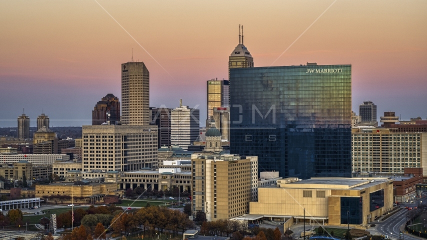 A hotel in front of the city's skyline at sunset, Downtown Indianapolis, Indiana Aerial Stock Photo DXP001_092_0016 | Axiom Images