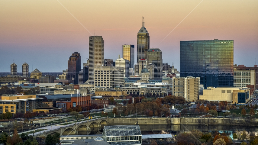 The city's skyline and a high-rise hotel at sunset, Downtown Indianapolis, Indiana Aerial Stock Photos | DXP001_092_0018