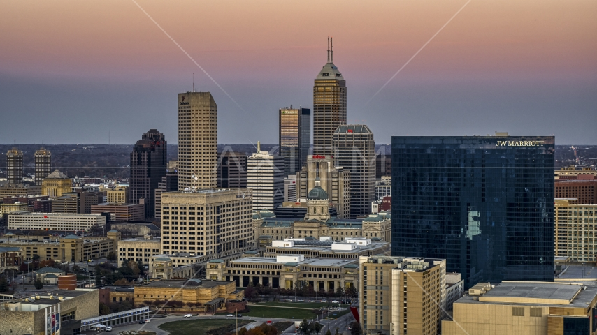 A hotel at sunset, city skyline in the background in Downtown Indianapolis, Indiana Aerial Stock Photos | DXP001_092_0019